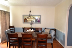 Add a chair rail and a fresh coat of paint to update your dining space